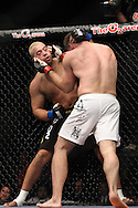 "LONDON, ENGLAND, JUNE 7, 2008: Eddie Sanchez (facing) clinches with Antoni Hardonk during ""UFC 85: Bedlam"" inside the O2 Arena in Greenwich, London on June 7, 2008."
