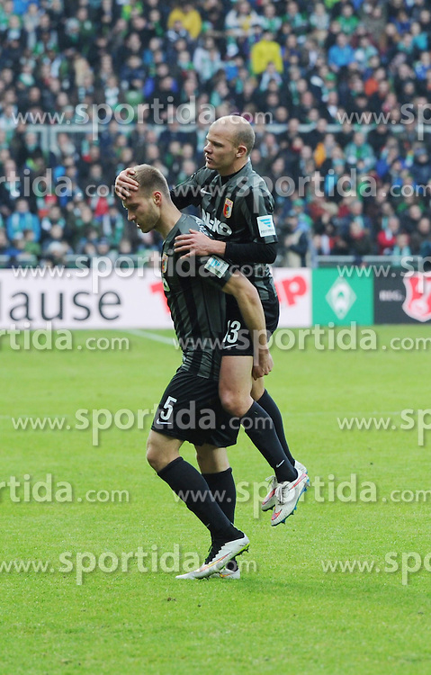 14.02.2015, Weserstadion, Bremen, GER, 1. FBL, SV Werder Bremen vs FC Augsburg, 21. Runde, im Bild Jubel nach dem 1 : 1, Tobias Werner ( FC Augsburg ) rechts, springt dem Torschuetzen Ragnar Klavan ( FC Augsburg ) links, auf den Ruecken. // during the German Bundesliga 21th round match between SV Werder Bremen and FC Augsburg at the Weserstadion in Bremen, Germany on 2015/02/14. EXPA Pictures &copy; 2015, PhotoCredit: EXPA/ Eibner-Pressefoto/ Schmidbauer<br /> <br /> *****ATTENTION - OUT of GER*****