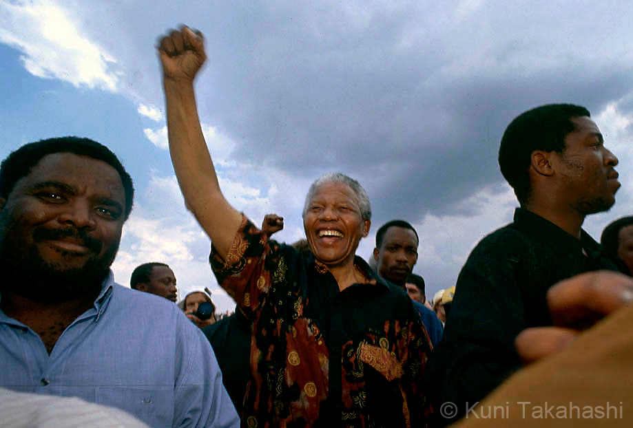Nelson Mandela acknowledges his supporters during political rally in Durban, South Africa, prior to the country's first multi-racial election in 1994.