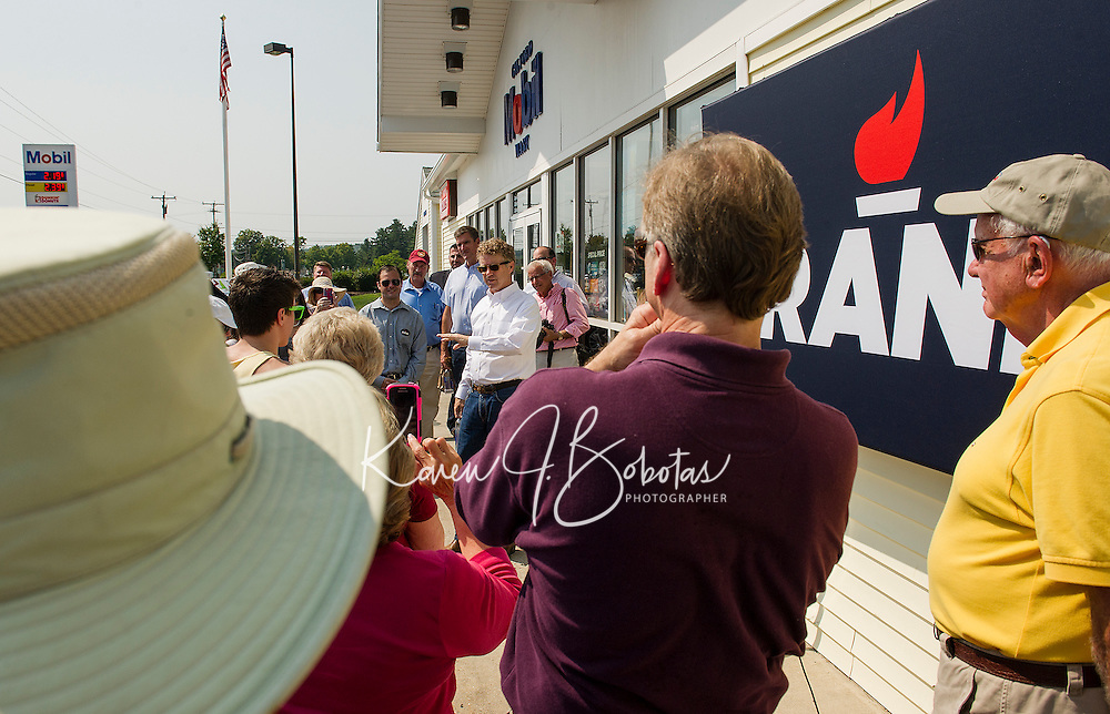 Senator Rand Paul speaks to supporters outside the Gilford Mobil Mart on Wednesday afternoon.  (Karen Bobotas/for the Laconia Daily Sun)