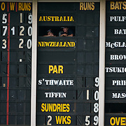 The scoreboard attendants watch the game while working the numbers during the Australia V New Zealand group A match at North Sydney Oval in the ICC Women's World Cup Cricket Tournament, in Sydney, Australia on March 8, 2009. New Zealand beat Australia by 13 runs in the (D/L method)  rain affected match. Photo Tim Clayton