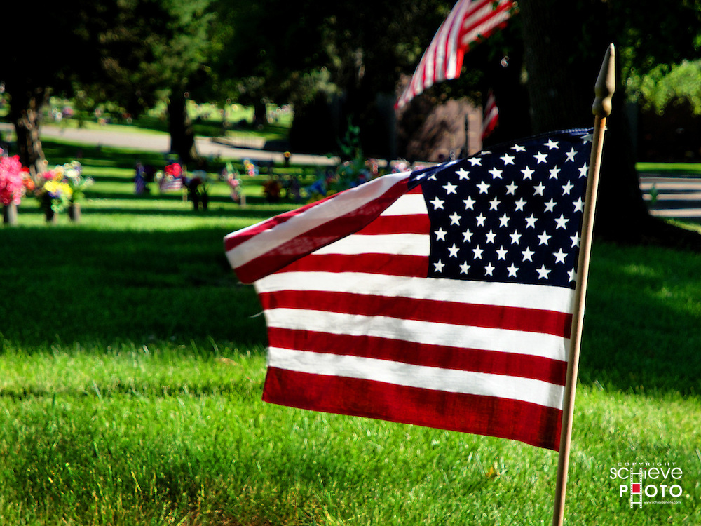 American flags decorate a cemetary on Memorial Day.