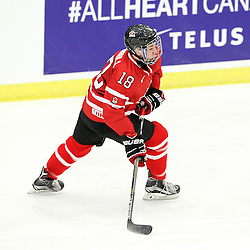 COBOURG, - Dec 13, 2015 -  Game #1 - Czech Republic vs Canada West at the 2015 World Junior A Challenge at the Cobourg Community Centre, ON. Carter Turnbull #18 of Team Canada West follows the play during the first period.(Photo: Tim Bates / OJHL Images)