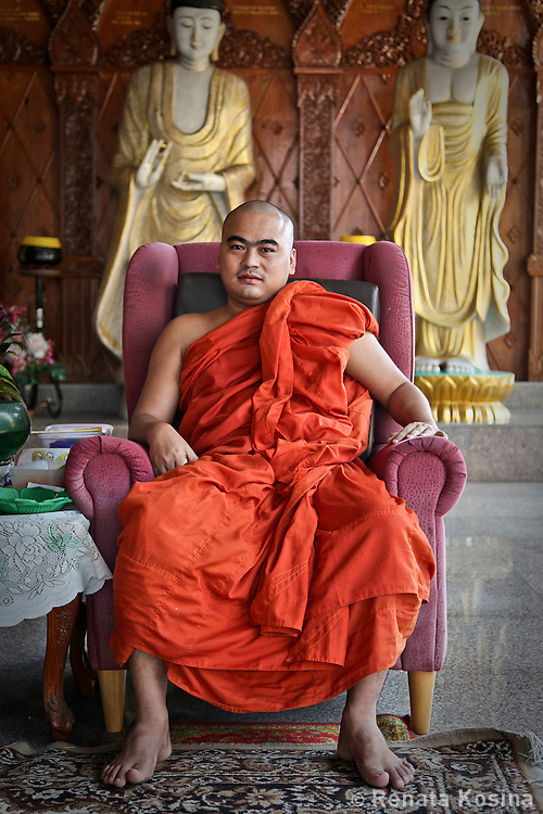 A Buddhist priest inside the Dhammikarama Burmese Buddhist Temple located on Penang, Malaysia.