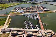 Nederland, Noord-Holland, Amsterdam, 14-06-2012; IJburg, Steigereiland, IJburglaan (midden), drijvende huizen. Zeeburgerbrug in de achtergrond..New constructed urban development, residential district IJburg , floating houses..luchtfoto (toeslag), aerial photo (additional fee required).foto/photo Siebe Swart