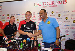 KUALA LUMPUR, MALAYSIA - Wednesday, July 22, 2015: Liverpool's manager Brendan Rodgers and Malaysia XI coach Dollar Salleh during a press conference at the Saujana Hotel on day ten of the club's preseason tour. (Pic by David Rawcliffe/Propaganda)