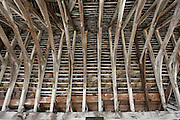 Interior View of Roof beams and stone tiling  at Chipping Campden Market Hall, Gloucestershire
