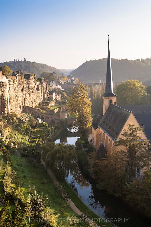LUX, Luxembourg, city of Luxembourg, St. Jean Baptiste church at the district Grund, river Alzette, Bock casemates.<br /> <br /> LUX, Luxemburg, Stadt Luxemburg, Kirche St. Jean Baptiste im Stadtteil Grund, der Fluss Alzette, Bock-Kasematten.