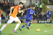 AFC Wimbledon midfielder Liam Trotter (14) starting an attack and dribbling during the EFL Sky Bet League 1 match between AFC Wimbledon and Southend United at the Cherry Red Records Stadium, Kingston, England on 1 January 2018. Photo by Matthew Redman.