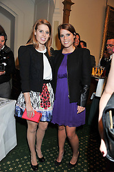 Left to right, PRINCESS BEATRICE OF YORK and PRINCESS EUGENIE OF YORK at a reception for The Mirela Fund in partnership with Hope and Homes for Children hosted by Natalie Pinkham in The Churchill Room, House of Commons, London on 30th April 2013.