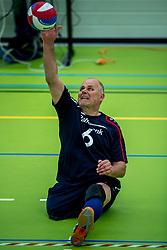 28-04-2018 NED: NK Zitvolleybal, Koog aan de Zaan<br /> BVC Holyoke wint de finale van het NK zitvolleybal met 3-1 van V.a.s. F.D.S uit Sneek. / Rene van der Slot #6 of Sneek