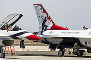 An U.S. Air Force Thunderbirds officer wipes a F-16 Fighting Falcon before the performance during Los Angeles County Air Show in Lancaster, California on March 21, 2015. (Photo by Ringo Chiu/PHOTOFORMULA.com)