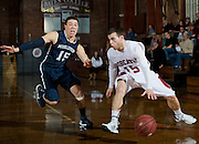 Luke Matarazzo '14 dribbles past a defender during a 59-56 loss to Middlebury on January 4, 2013.