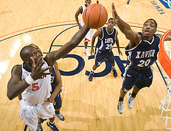 Virginia center Assane Sene (5) grabs a rebound from Xavier guard/forward C.J. Anderson (20). The #22 ranked Xavier Musketeers defeated the Virginia Cavaliers 84-70 at the John Paul Jones Arena on the Grounds of the University of Virginia in Charlottesville, VA on January 3, 2009.