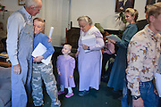 "Sept 8, 2008 -- COLORADO CITY, AZ:  JOSEPH JESSOP, patriarch of the Jessop family, polygamist members of the FLDS, gets hugs from his children and wives after morning prayers in their home. Colorado City and the neighboring town of Hildale, UT, are home to the Fundamentalist Church of Jesus Christ of Latter Day Saints (FLDS) which split from the mainstream Church of Jesus Christ of Latter Day Saints (Mormons) after the Mormons banned what they call ""Celestial Marriage"" (polygamy) in 1890 so that Utah could gain statehood into the United States. The FLDS Prophet (leader), Warren Jeffs, has been convicted in Utah of ""rape as an accomplice"" for arranging the marriage of teenage girl to her cousin and is currently on trial for similar, those less serious, charges in Arizona. After Texas child protection authorities raided the Yearning for Zion Ranch, (the FLDS compound in Eldorado, TX) many members of the FLDS community in Colorado City/Hildale fear either Arizona or Utah authorities could raid their homes in the same way. Older members of the community still remember the Short Creek Raid of 1953 when Arizona authorities using National Guard troops, raided the community, arresting the men and placing women and children in ""protective"" custody. After two years in foster care, the women and children returned to their homes. After the raid, the FLDS Church eliminated any connection to the ""Short Creek raid"" by renaming their town Colorado City in Arizona and Hildale in Utah. The Jessops are a polygamous family and members of the FLDS.   Photo by Jack Kurtz / ZUMA Press"