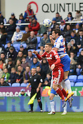 Reading FC striker Yann Kermorgant wins the header ahead of Cardiff City midfielder Stuart O'Keefe during the Sky Bet Championship match between Reading and Cardiff City at the Madejski Stadium, Reading, England on 19 March 2016. Photo by Mark Davies.