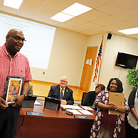 Aberdeen School District Parent of the Year Kebby Harden, lefts, shares his appreciation of being chosen for the honor as school board members Jim Edwards and Sandra Peoples and Shanda Whitfield and Kerry Haynes, who were chosen as their children's schools' parents of the year, listen.