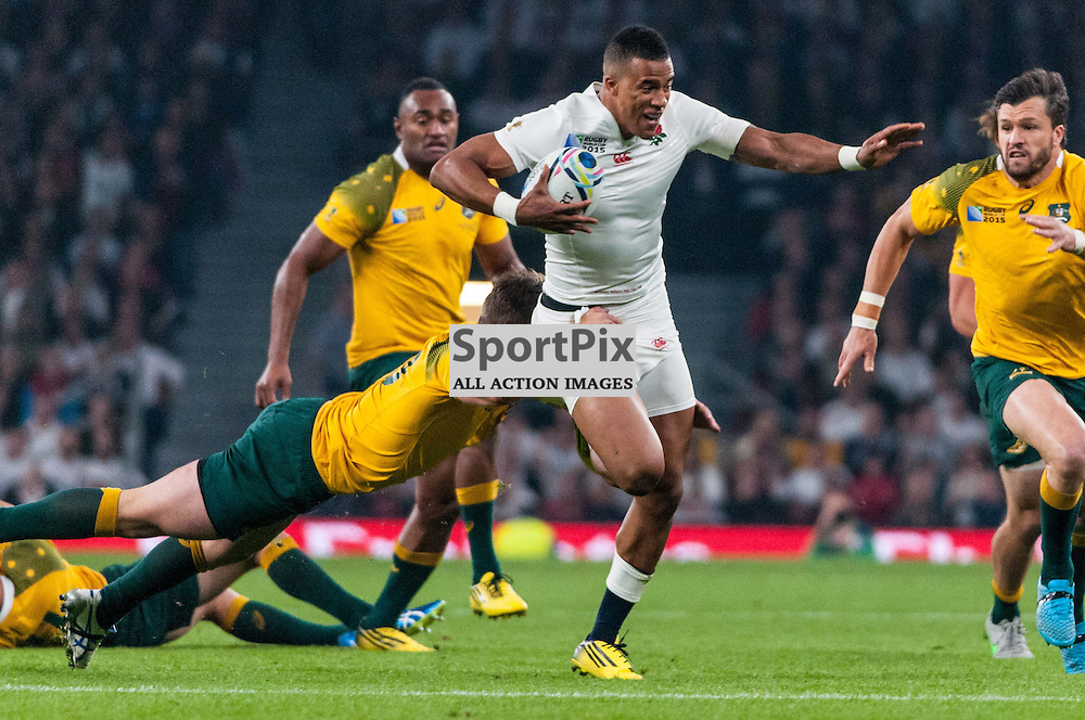 Jonathan Joseph of England runs through the tackle of Bernard Foley of Australia. Action from the England v Australia game in Pool A of the 2015 Rugby World Cup at Twickenham in London, 3 October 2015. (c) Paul J Roberts / Sportpix.org.uk