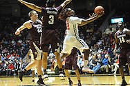 "Mississippi Rebels guard Stefan Moody (42) vs. Texas A&M Aggies guard Alex Robinson (3) and Texas A&M Aggies guard Peyton Allen (22) at the C.M. ""Tad"" Smith Coliseum in Oxford, Miss. on Wednesday, February 4, 2015. (AP Photo/Oxford Eagle, Bruce Newman)"