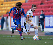 24th March 2018, McDiarmid Park, Perth, Scotland; Scottish Football Challenge Cup Final, Dumbarton versus Inverness Caledonian Thistle; Tom Walsh of Dumbarton takes on Collin Seedorf of Inverness Caledonian Thistle