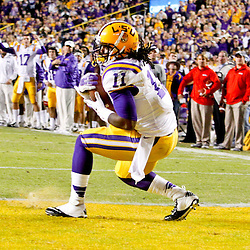 November 17, 2012; Baton Rouge, LA, USA;  LSU Tigers running back Spencer Ware (11) scores on a two-point conversion to tie the game in the fourth quarter against the Ole Miss Rebels in a game at Tiger Stadium. LSU defeated Ole Miss 41-35. Mandatory Credit: Derick E. Hingle-US PRESSWIRE