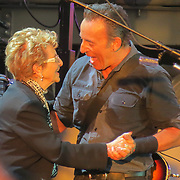 BRUCE SPRINGSTEEN DANCING WITH HIS MOTHER ADELE AT THE HARD ROCK CALLING FESTIVAL AT THE OLYMPIC PARK,LONDON,ON SUNDAY EVENING,JUNE 30TH.<br /> <br />  Rock star Bruce Springsteen is well known for inviting women to dance with him on stage and last night (Sun) it was the turn of his biggest fan - his elderly MOTHER.<br /> <br /> The musician's mum Adele, who is 88, looked overjoyed to join her famous son in front of 50,000 fans at the Hard Rock Calling gig in the Olympic Park,London.<br /> <br /> Adele, who was dressed in a navy blue trouser suit and pearl earrings, showed a few dance moves during Dancing in the Dark then took a well-deserved bow at the end.<br /> <br /> Springsteen, 63, known as The Boss, also invited his sister Pamela to play the guitar during the end of the song.<br /> <br /> It was the song that made actress Courtney Cox famous when she appeared in Springsteen's Dancing in the Dark video in 1984.<br /> <br /> Last year fans were angry when the musician had his microphone turned off before he had finished playing at the Hard Rock Calling gig in Hyde Park.<br /> <br /> Springsteen was singing with Sir Paul McCartney but they had the plug pulled on them when they broke the 10.30pm sound curfew,but this year there were no problems as he finished his three hour show  at 10.20pm well before the curfew.
