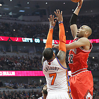 12 March 2012: Chicago Bulls forward Taj Gibson (22) takes a skyhook over New York Knicks small forward Carmelo Anthony (7) during the first half of New York Knicks vs Chicago Bulls, at the United Center, Chicago, Illinois, USA.