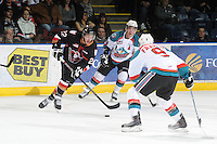 KELOWNA, CANADA, FEBRUARY 17: Danny Gayle #22 of the Calgary Hitmen skates with the puck at the Kelowna Rockets on February 17, 2012 at Prospera Place in Kelowna, British Columbia, Canada (Photo by Marissa Baecker/Shoot the Breeze) *** Local Caption ***