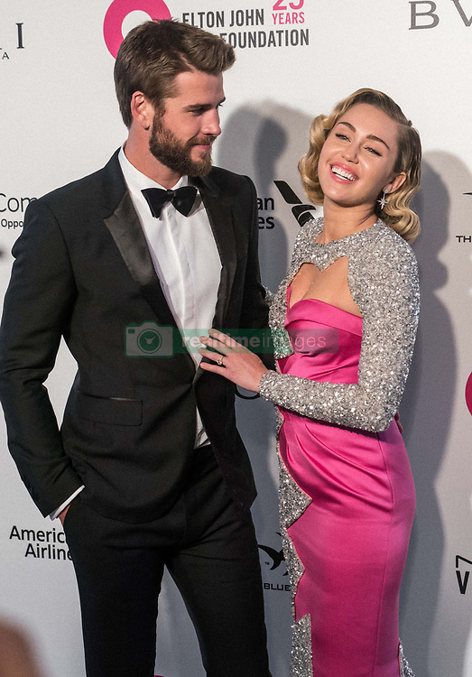 """(FILE) Miley Cyrus and Liam Hemsworth Donate $500,000 to Emergency Relief After Losing Home in California Wildfires. Miley Cyrus and Liam Hemsworth lost their home to a California wildfire, but the famous couple have their sights set on rebuilding not just their house but also their community. Cyrus and Hemsworth have donated $500,000 to The Malibu Foundation through Cyrus' charity, Happy Hippie, a representative said. The funds will be used for """"those in financial need, emergency relief assistance, community rebuilding , wildfire prevention and climate change resilience,"""" according to a statement. Earlier on Tuesday, Hemsworth shared a striking photo of their home's remains. WEST HOLLYWOOD, LOS ANGELES, CA, USA - MARCH 04: Actor Liam Hemsworth and girlfriend/singer Miley Cyrus arrive at the 26th Annual Elton John AIDS Foundation's Academy Awards Viewing Party held at The City of West Hollywood Park on March 4, 2018 in West Hollywood, Los Angeles, California, United States. 04 Mar 2018 Pictured: Liam Hemsworth, Miley Cyrus. Photo credit: Xavier Collin/Image Press Agency/MEGA TheMegaAgency.com +1 888 505 6342"""
