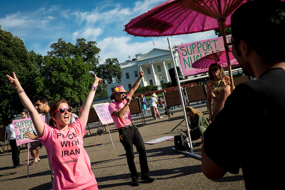 Members of the activist group, Code Pink, hold a rally outside of the White House on Thursday, July 23, 2015 in Washington, D.C., in support of the Iran nuclear deal that is being debated in the U.S. Congress.
