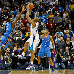 January 24,  2011; New Orleans, LA, USA; New Orleans Hornets power forward David West (30) shoots the game winning shot over Oklahoma City Thunder power forward Serge Ibaka (9) during the fourth quarter at the New Orleans Arena. The Hornets defeated the Thunder 91-89. Mandatory Credit: Derick E. Hingle