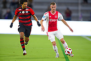 Ajax midefielder Daley Sinkgraven (8) and Flamengo midfielder Willian Arao (5) in action during a Florida Cup match against Flamengo at Orlando City Stadium on Jan. 10, 2019 in Orlando, Florida. <br /> Flamengo won in penalties 4-3.<br /> <br /> ©2019 Scott A. Miller