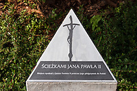 Pope John Paul II memorial in Blonia Park behind in Krakow Poland