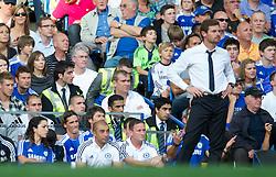 LONDON, ENGLAND - Saturday, August 20, 2011: Chelsea's substituted striker Fernando Torres sits on the bench as manager Andre Villas-Boas look on during the Premiership match against West Bromwich Albion at Stamford Bridge. (Pic by David Rawcliffe/Propaganda)
