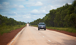 Cars on the road from Broome to Derby in the wet season.