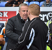 Kenny Jackett  and Neil Lennon shake hands during the Sky Bet Championship match between Bolton Wanderers and Wolverhampton Wanderers at the Macron Stadium, Bolton, England on 12 September 2015. Photo by Mark Pollitt.