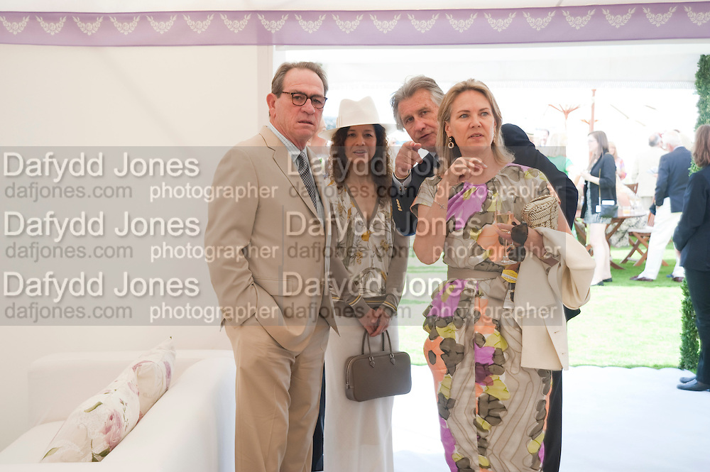 TOMMY LEE JONES;  DAWN JONES; CARLA BAMBERGER; ARNAUD BAMBERGER<br /> Cartier International Polo. Guards Polo Club. Windsor Great Park. 25 July 2010. -DO NOT ARCHIVE-© Copyright Photograph by Dafydd Jones. 248 Clapham Rd. London SW9 0PZ. Tel 0207 820 0771. www.dafjones.com.