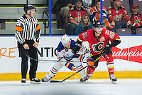 PENTICTON, CANADA - SEPTEMBER 17: Kenney Morrison #53 of Calgary Flames checks Aaron Irving #90 of Edmonton Oilers  on September 17, 2016 at the South Okanagan Event Centre in Penticton, British Columbia, Canada.  (Photo by Marissa Baecker/Shoot the Breeze)  *** Local Caption *** Aaron Irving; Kenney Morrison;