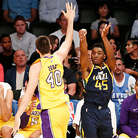 10 October 2017: Utah Jazz guard Donovan Mitchell (45) takes a jump shot over Los Angeles Lakers center Ivica Zubac (40) during the Utah Jazz 105-99 victory over the LA Lakers, at the Staples Center, Los Angeles, California, USA.