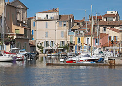 The Le Miroir aux oiseaux (Mirror Bird) area of Martigues, a picturesque fishing port in the Bouches-du-Rhône department in the Provence-Alpes-Côte d'Azur region, France. Founded in 1232 on the site of an earlier Roman camp, Martigues has attracted artists for many generations.