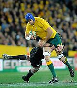 Nathan Sharpeon the charge, Rugby Championship. Australia v All Blacks at ANZ Stadium, Sydney, New Zealand. Saturday 18 August 2012. New Zealand. Photo: Richard Hood/photosport.co.nz