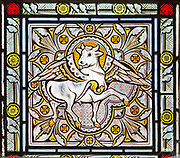 Nineteenth century Victorian stained glass eagle symbol of  Saint Luke, Bishops Cannings church, Wiltshire, England, UK