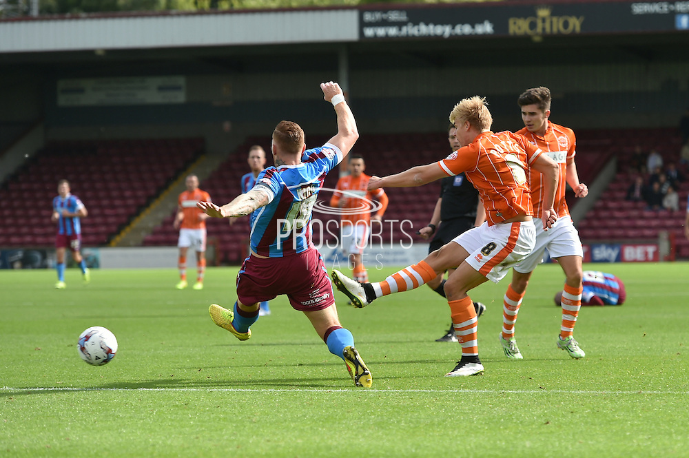 Brad Potts makes cross during the Sky Bet League 1 match between Scunthorpe United and Blackpool at Glanford Park, Scunthorpe, England on 5 September 2015. Photo by Ian Lyall.