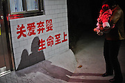 Anguish of the mothers forced to hand over their children: Heartbreaking moments parents say goodbye to their sons and daughters at China's 'baby hatches'<br /> <br /> These heartbreaking photos reveal the anguish of parents as they abandon their children in China's so-called 'baby hatches.'<br /> The images taken at a centre in Guangzhou - one of 25 such hatch facilities in mainland China, spanning 10 provinces and major cities - show the last moments before parents give up their infants  often due to poverty or an inability to cope with disease or disability.<br /> Abandoning children is illegal in China, but the 'hatches' were introduced so parents could abandon infants safely rather than leaving them in the streets.<br /> <br /> But critics argue it encourages drastic action and believe some parents may feel it is more socially acceptable to abandon their children. <br /> <br /> The hatch in opened in January, but staff were forced to shut the door just two months later after becoming overwhelmed with 262 abandoned youngsters - all of which were ill or disabled. <br /> 'My baby cannot take care of itself when it grows up. I just want my baby to survive,' said a mother reported the South China Morning Post.<br /> <br /> In one of the photos an uncle is seen leaving his niece who he says is suffering from leukemia and her parents can not afford her medical bills. <br /> Another distressing image shows a man crying after being told his baby is too old to be accepted.<br /> A couple, whose child has Pierre Robin syndrome - congenital condition of facial abnormalities in humans - are also photographed walking to the centre to give up their child.  <br /> A parent typically opens a door and places their infant in a small room, rings a bell and leaves before welfare services collect the child. <br /> Last month the welfare home's director Xu Jiu announced the suspension and told Xinhua news agency: 'I hope everyone understands the difficulties the welfare centre face.'<br /> <br /> We are temporarily closing the centre [to new babies] so that we can properly care for t