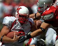 MORNING JOURNAL/DAVID RICHARD<br />Ohio State linebacker A.J. Hawk,right, sacks Miami quarterback Josh Betts yesterday in the second quarter.