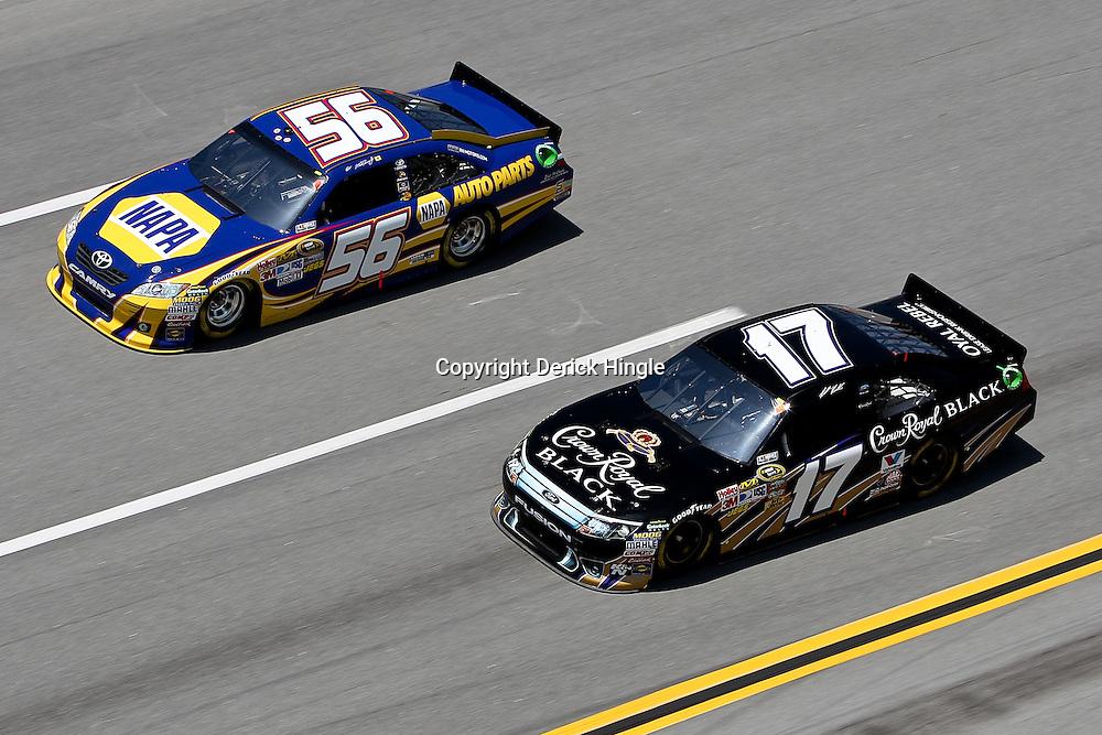 April 17, 2011; Talladega, AL, USA; NASCAR Sprint Cup Series driver Martin Truex Jr. (56) and Matt Kenseth (17) during the Aarons 499 at Talladega Superspeedway.   Mandatory Credit: Derick E. Hingle