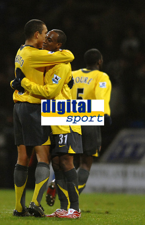 Photo: Paul Greenwood.<br />Bolton Wanderers v Arsenal. The FA Cup. 14/02/2007. Arsenal's Gilberto, left, and  Justin Hoyt celebrate at the final whistle