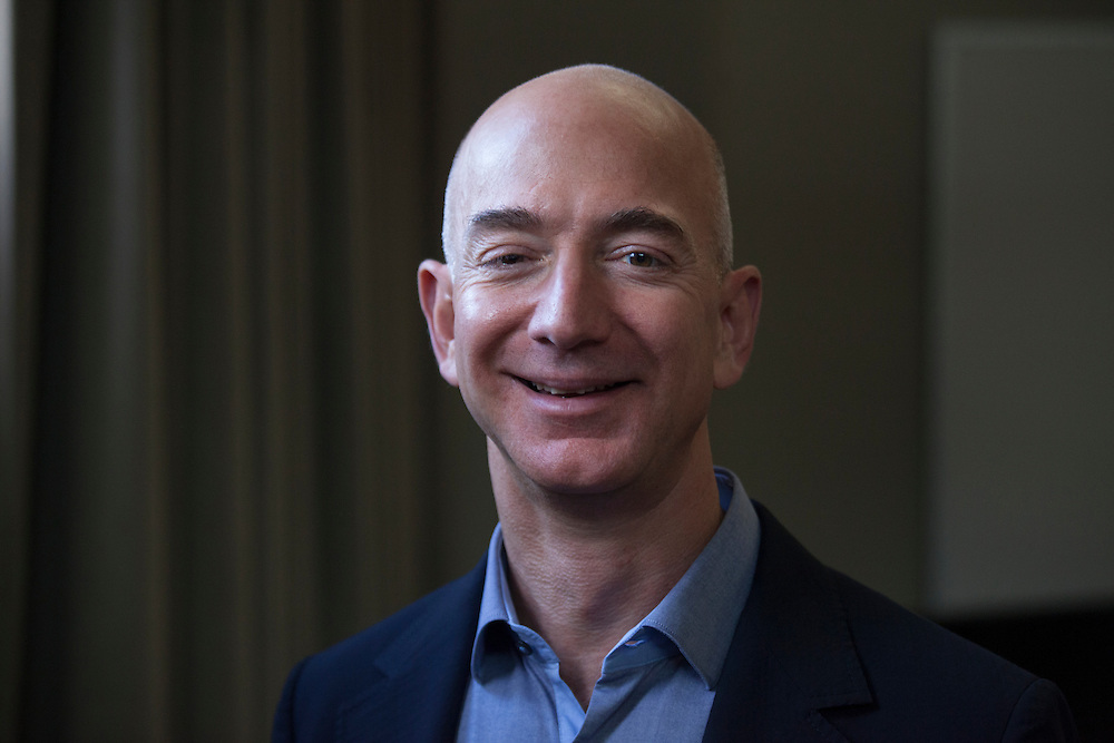 September 24, 2013 - Seattle, Washington, United States: Jeff Bezos, founder, chairman, and CEO of Amazon.com poses for a portrait at the Amazon headquarters. Bezos is also the owner of The Washington Post and founder of Blue Origin.