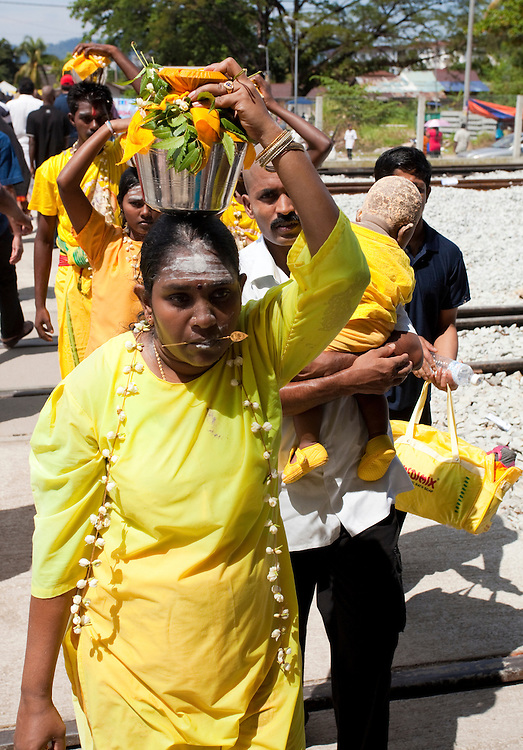 Carrying a milk pot at Thaipusam Festival, Batu Caves, Malaysia. It is a Hindu festival celebrated mostly by the Tamil community on the full moon in the Tamil month of Thai (Jan/Feb). The festival celebrates the birth of Murugan,the youngest son of Shiva and his wife Parvati. The festival at Batu Caves, Kuala Lumpur culminates in a 272 step climb into the cave.