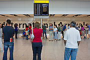Family members and drivers await appearing passengers in international arrivals at Heathrow Airport's Terminal 5.